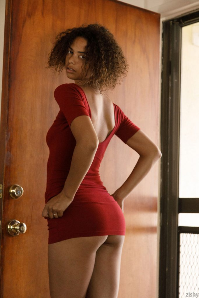 Desiree Jacobsen giving a sexy stare as she gives a small glimpse of her cute bum-Zishy