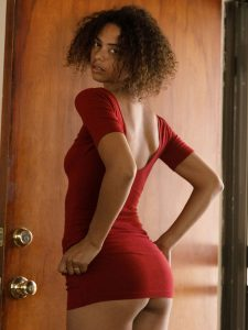 Desiree Jacobsen teasing in a tight red dress for Zishy
