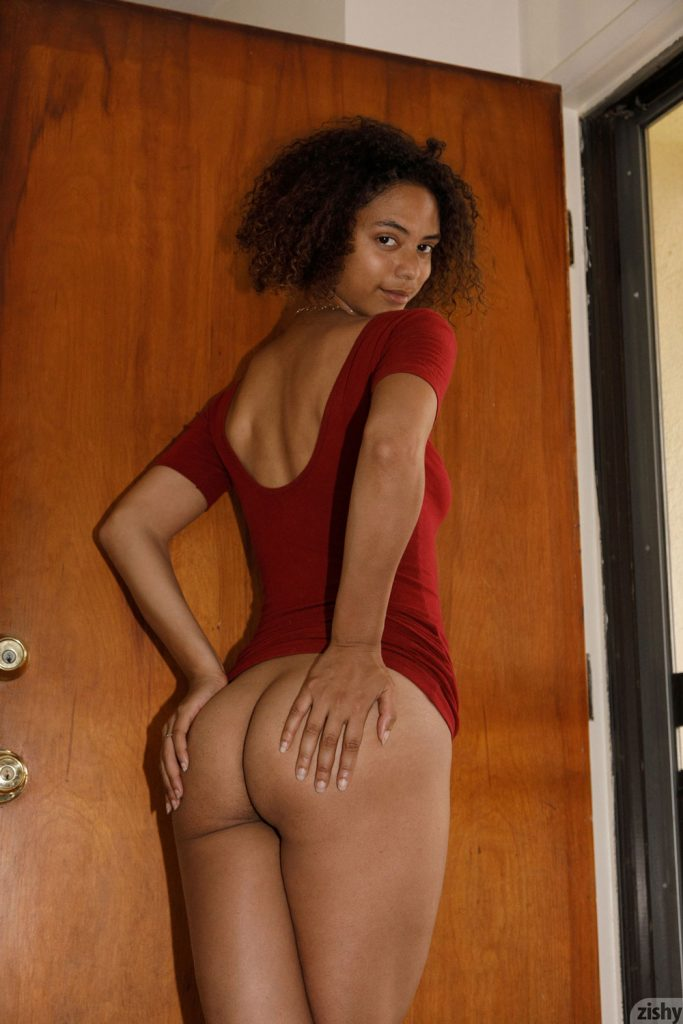 Desiree Jacobsen gives a cheeky grin as she holds her bum cheeks-Zishy