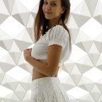 Jessica Albanka posing in a white skirt and white top-Zishy